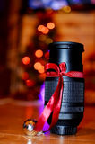 Lens with red ribbon for present Stock Image