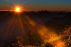 Lens reflections of sunrise in austrian mountains Royalty Free Stock Photo