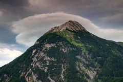 Lens shaped cloud above Polinik peak, Carnic Alps, Austria Royalty Free Stock Photos