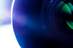 Lens of a SLR camera close-up macro with sunbeams glare Royalty Free Stock Photos