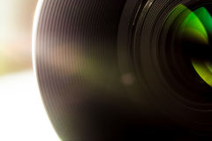 Lens of a SLR camera close-up macro with sunbeams glare Royalty Free Stock Photography