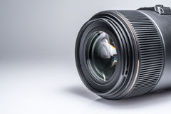Lens of a SLR camera close-up with a reflection Stock Image