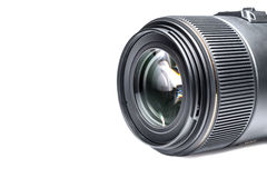 Lens of a SLR camera close-up with a reflection isolated Stock Images