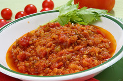 Lens in tomato sauce. On plate Royalty Free Stock Photo