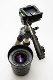 Lens and tripod. Photography lens and small tripod Stock Images