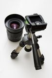 Lens and tripod. Small tripod and photography lens Stock Image