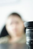 Lens woman. Lens and woman photographer metaphor Stock Image
