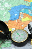 Lensatic Compass And Map. A black lensatic compass on hiking map Stock Photography