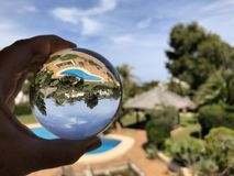 Lensball, garden with swimming pool royalty free stock photos