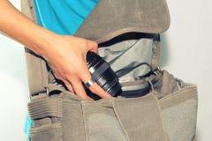 Lense en el bolso Foto de archivo libre de regalías