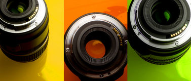 Lenses. Camera lenses on varied coloured backgrounds stock photography