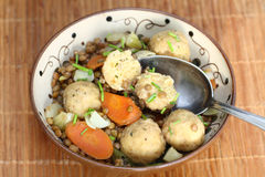 Lenses with bread dumplings. Cooked lenses with carrots as vegetables, in addition small dumplings from bread roll Royalty Free Stock Image
