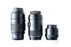 Lenses to a SLR camera close-up with reflection isolated. On a white background Stock Photo