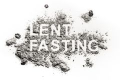 Lent fasting word written in ash, sand or dust. As forty days abstinence period time before easter as redemption or penance jesus in desert concept royalty free stock photography