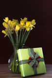 Lent lily daffodil. In a glass vase with Easter gift stock image