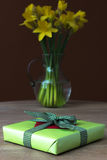 Lent lily daffodil. In a glass vase with Easter gift royalty free stock photos