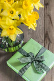 Lent lily daffodil. In a glass vase with Easter gift royalty free stock photo