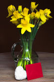 Lent lily daffodil in a glass vase. With letter and Heart royalty free stock photography