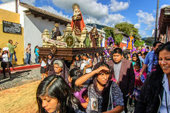 Lent procession with Virgin Mary, Antigua, Guatemala. Antigua, Guatemala - Mar 1, 2015: Lent procession with Virgin Mary & women bearers walk over remains of royalty free stock photo