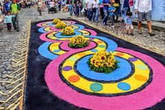 Lent processional carpet, Antigua, Guatemala. Antigua, Guatemala - Mar 1, 2015: Spectators admire Lent processional carpets in path of religious procession in royalty free stock photos