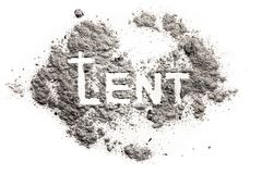 Lent word with cucifix drawing in ash. Sand, dust as jesus fasting in desert, abstinence and penance concept, christian religion faith background Stock Images