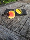 Lente anaranjada de los vidrios de Sun Fotografía de archivo libre de regalías