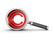 Lente d'ingrandimento con l'icona rossa del copyright Fotografia Stock