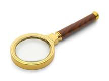 Lente d'ingrandimento dell'oro Immagine Stock Libera da Diritti