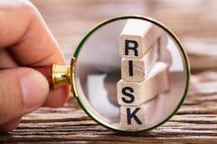 Lente d'ingrandimento di Person Inspecting Risk Block With Immagini Stock Libere da Diritti