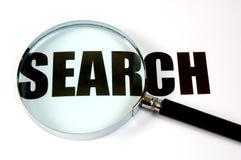 Lente d'ingrandimento e testo - ricerca Fotografia Stock
