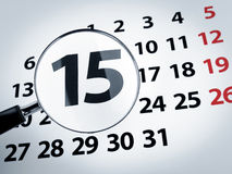 Lente d'ingrandimento su un calendario Fotografia Stock