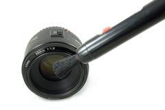 Lente da câmera DSLR e pena pretas isoladas da lente Foto de Stock Royalty Free