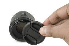 Lente da câmera DSLR e tampão de lente pretos isolados Foto de Stock Royalty Free