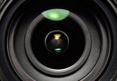 A lente da foto com reflexões da lente fecha-se acima Imagem de Stock
