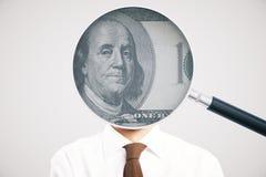 Lente de aumento com dólar no homem Fotografia de Stock