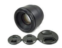 Lente de câmera e tampão de lente pretos isolados Fotografia de Stock