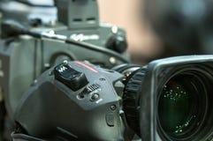Lente de close up da câmara de televisão & botão do zumbido Foto de Stock