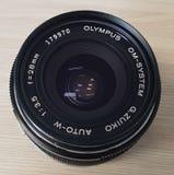 Lente dell'annata di Olympus Fotografia Stock