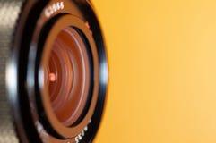 Lente della foto su fondo arancio immagini stock