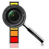 Lente e película de câmera Imagens de Stock