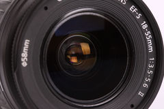 Lente para a câmara digital no fundo branco Foto de Stock Royalty Free