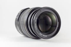 A lente para a câmera no fundo branco Imagem de Stock