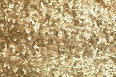 Lentejuelas de oro Imagen de archivo libre de regalías