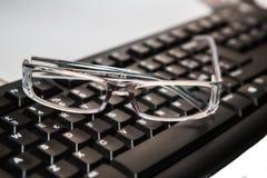 lentes con el teclado Imágenes de archivo libres de regalías