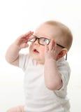 Lentes que desgastan del bebé Foto de archivo libre de regalías