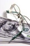 Lentes y dinero fotos de archivo libres de regalías