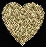 Lenticchie nella forma del cuore Immagini Stock Libere da Diritti