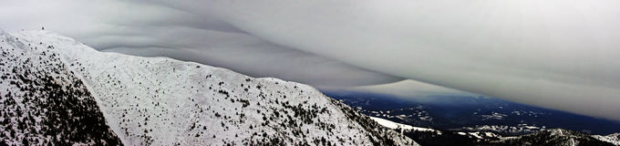 Lenticular cloud above the mountain Stock Images