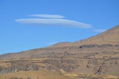 Lenticular Cloud and Desert Ridge, Washington. This is a lenticular cloud and blue sky over a desert ridge in Central Washington along the Columbia Gorge Stock Photos