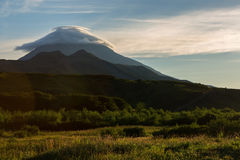 Lenticular clouds above Vilyuchinsky stratovolcano at dawn. View from brookvalley Spokoyny at the foot of outer north Stock Photo